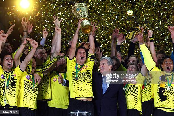Sebastian Kehl of Dortmund celebrates with his team mates and Joachim Gauck federal president of Germany winning the DFB Cup final match between...