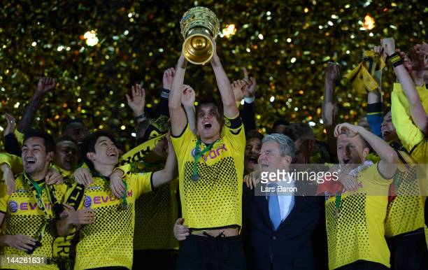 Sebastian Kehl of Dortmund celebrates with his team mates winning the DFB Cup final match between Borussia Dortmund and FC Bayern Muenchen at Olympic...