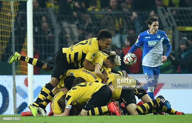 Sebastian Kehl of Dortmund celebrates with his teammates after scoring his team's third goal during the DFB Cup Quarter Final match between Borussia...