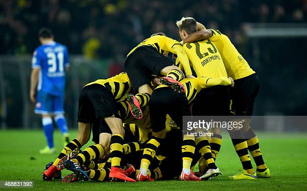 Sebastian Kehl of Dortmund celebrates with team mates after scoring his teams third goal during the DFB Cup Quarter Final match between at Borussia...