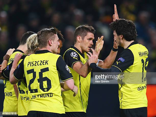 Sebastian Kehl of Dortmund is congratulated by Mats Hummels after his goal during the UEFA Champions League round of 16 second leg match between...