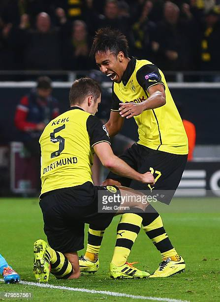 Sebastian Kehl of Dortmund is congratulated by PierreEmerick Aubameyang after his goal during the UEFA Champions League round of 16 second leg match...