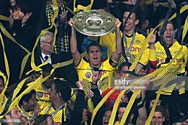 Sebastian Kehl of Dortmund lifts the trophy after the Bundesliga match between Borussia Dortmund and SC Freiburg at Signal Iduna Park on May 5 2012...