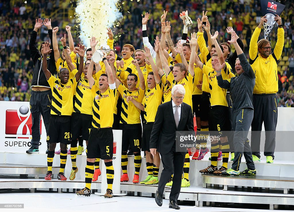 Sebastian Kehl of Dortmund lifts the trophy after winning the DFL Supercup match between Borussia Dortmund and FC Bayern Muenchen at Signal Iduna Park on August 13, 2014 in Dortmund, Germany.