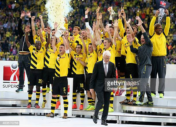 Sebastian Kehl of Dortmund lifts the trophy after winning the DFL Supercup match between Borussia Dortmund and FC Bayern Muenchen at Signal Iduna...