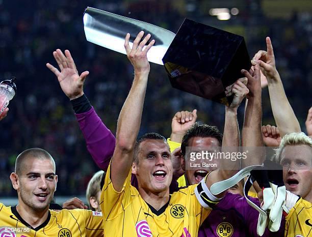 Sebastian Kehl of Dortmund lifts the trophy after winning the Supercup match between Borussia Dortmund and Bayern Munich at the Signal Iduna Park on...