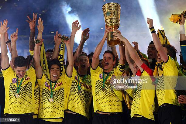 Sebastian Kehl of Dortmund lifts the trophy on the podium after winning 52 the DFB Cup final match between Borussia Dortmund and FC Bayern Muenchen...