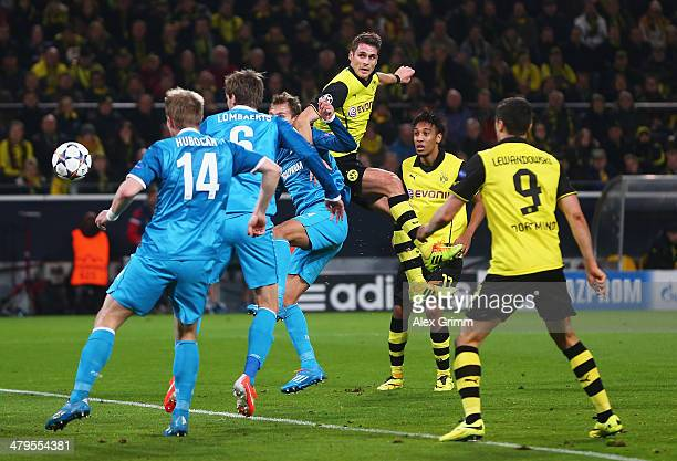 Sebastian Kehl of Dortmund scores his goal with a header during the UEFA Champions League round of 16 second leg match between Borussia Dortmund and...