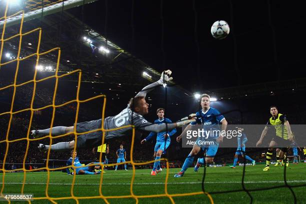 Sebastian Kehl of Dortmund scores his team's first goal with a header against goalkeeper Vyacheslav Malafeev of Zenit during the UEFA Champions...