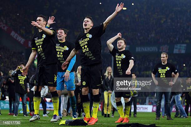 Sebastian Kehl, Roman Weidenfeller,Lukasz Piszczek and Jakub Blaszczykowski of Dortmund celebrate winning the German Championships after winning 2-0...