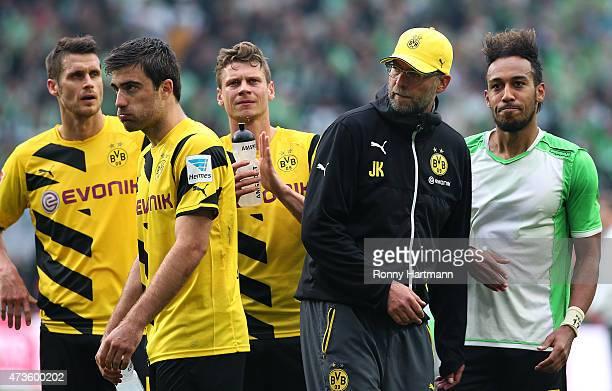 Sebastian Kehl Sokratis Lukasz Piszczek head coach Juergen Klopp and PierreEmerick Aubameyang of Dortmund react after the Bundesliga match between...