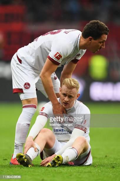 Sebastian Kerk and Tim Leibold of Nurnberg looks dejected after the Bundesliga match between Eintracht Frankfurt and 1 FC Nuernberg at...