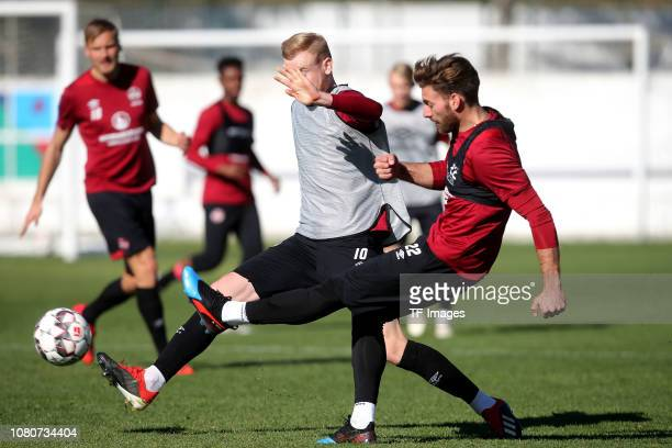 Sebastian Kerk of 1. FC Nuernberg and Enrico Valentini of 1. FC Nuernberg battle for the ball during a training session as part of the 1. FC...