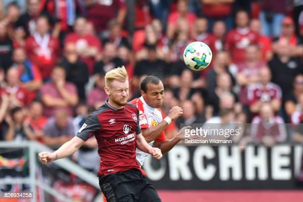 Sebastian Kerk of 1. FC Nuernberg and Jann George of SSV Jahn Regensburg jump for a header during the Second Bundesliga match between SSV Jahn...