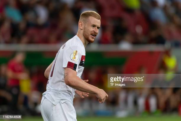 Sebastian Kerk of FC Nuernberg looks on during the DFB Cup first round match between SV Sandhausen and Borussia Moenchengladbach at Audi Sportpark on...