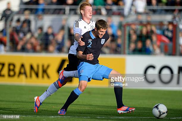 Sebastian Kerk of Germany and John Stones of England battle for the ball during the Under 19 international friendly match between Germany and England...