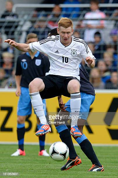 Sebastian Kerk of Germany and Nathaniel Chalobah of England battle for the ball during the Under 19 international friendly match between Germany and...