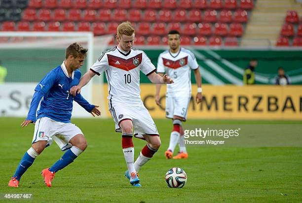 Sebastian Kerk of Germany battles for the ball with Giovanni Di Noia of Italy during the U20 international friendly match between Germany and Italy...