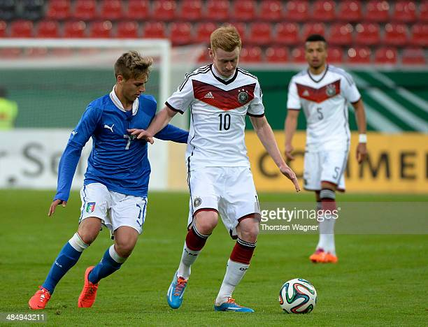 Sebastian Kerk of Germany battles for the ball with Matteo Ricci of Italy during the U20 international friendly match between Germany and Italy at...