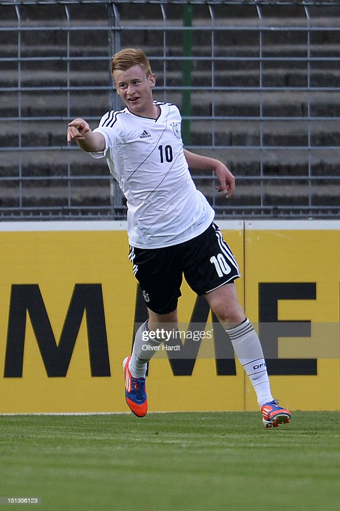 Sebastian Kerk of Germany celebrates after scoring their first goal during the Under 19 international friendly match between Germany and England at Stadion an der Lohmuehle on September 6, 2012 in Luebeck, Germany.