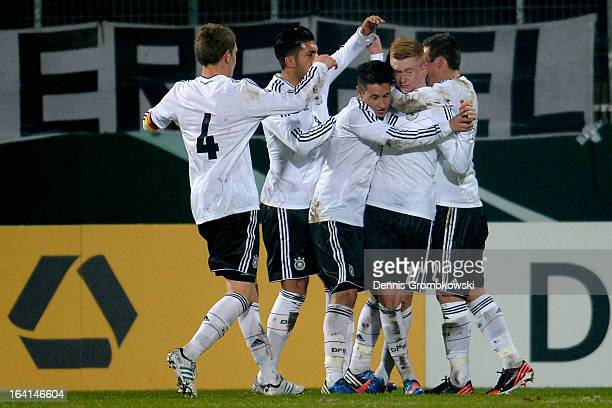 Sebastian Kerk of Germany celebrates with teammates after scoring his team's first goal during the International Friendly match between U19 Germany...