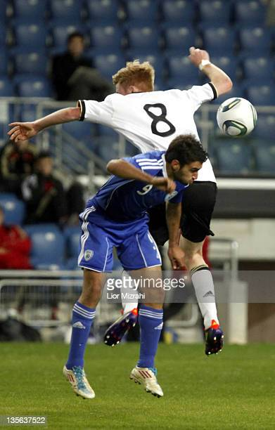 Sebastian Kerk of Germany challenges Michael Ohana of Israel during the Under 18 International Friendly match between Israel and Germany on December...