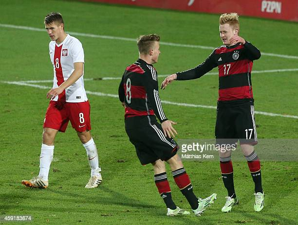 Sebastian Kerk of Germany jubilates with team mate Yannick Gerhardt after scoring the second goal after penalty during the U20 international friendly...