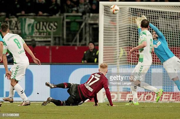 Sebastian Kerk of Nuernberg scores his team's first goal past goalkeeper Sebastian Mielitz of Fuerth during the Second Bundesliga match between 1. FC...