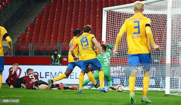 Sebastian Kerk of Nuernberg scores the opening/first goal during the Second Bundesliga match between 1. FC Nuernberg and Eintracht Braunschweig at...