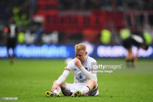 Sebastian Kerk of Nurnberg looks dejected after the Bundesliga match between Eintracht Frankfurt and 1 FC Nuernberg at CommerzbankArena on March 17...