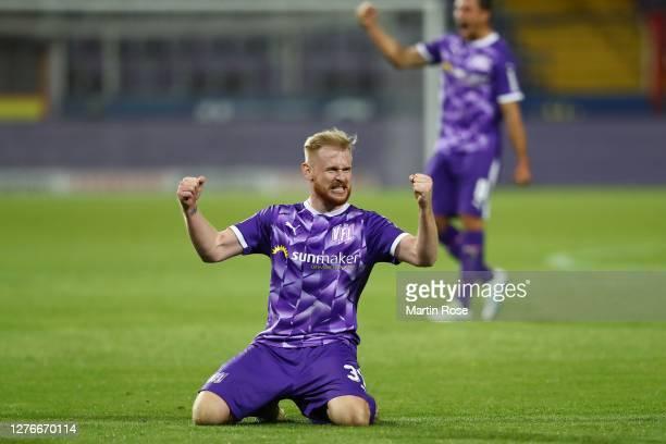 Sebastian Kerk of Osnabrück celebrates victory after winning the Second Bundesliga match between VfL Osnabrück and Hannover 96 at Stadion an der...