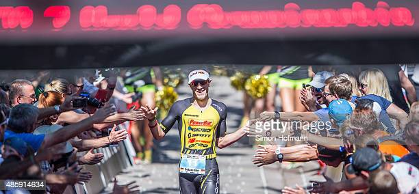 Sebastian Kienle of Germany celebrates his second place after competing in the Ironman 703 World Championship Zell am See Kaprun on August 30 2015 in...