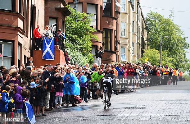 Sebastian Kigongo Semakula of Uganda is cheered on by spectators in the Men's Road Race during day eleven of the Glasgow 2014 Commonwealth Games on...