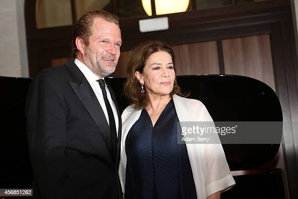 Sebastian Knauer and Hannelore Elsner pose prior to their literarymusical evening hosted by Berenberg Bank at Humboldt Carre on October 8 2014 in...