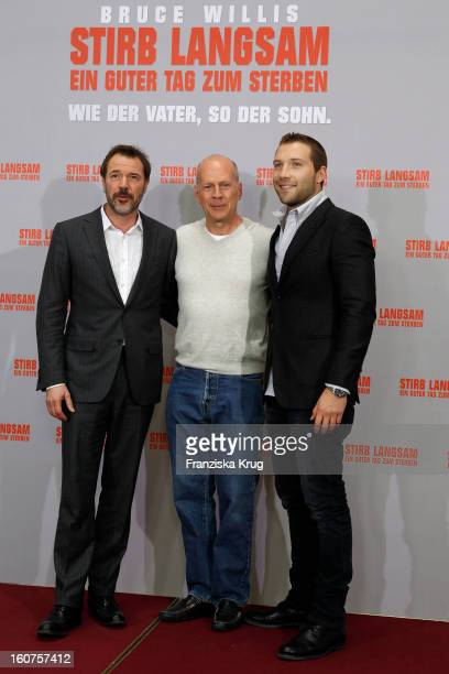 Sebastian Koch Bruce Willis and Jai Courtney attend a photocall for 'Die Hard 'Ein Guter Tag Zum Sterben' at Hotel Adlon on February 5 2013 in Berlin...