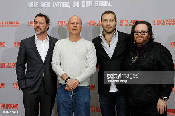 Sebastian Koch Bruce Willis Jai Courtney and John Moore attend a photocall for 'Die Hard 'Ein Guter Tag Zum Sterben' at Hotel Adlon on February 5...