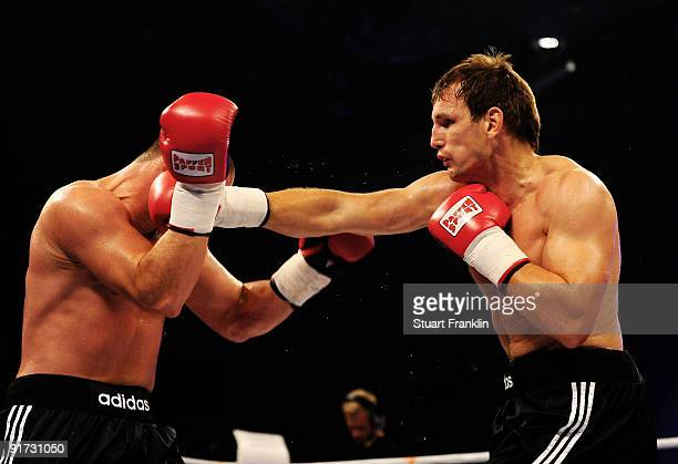 Sebastian Koeber of Germany lands a punch on Markus Tomala of Germany during the interim German heavyweight championship fight during the Universum...