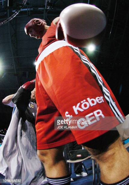 Sebastian Koeber of Germany prepares in the ring for the start of his 2004 Olympic Games preliminary Super Heavyweight match against Mukhtarkhan...