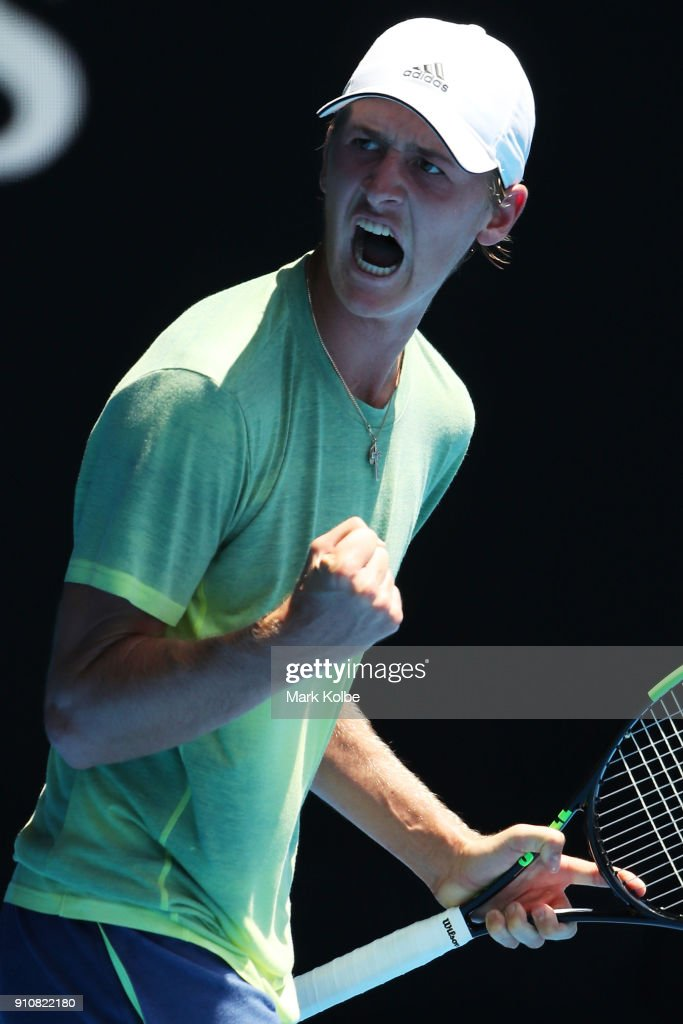 Sebastian Korda of the United States celebrates winning the first set in his Junior Boys' Singles Final against Chun Hsin Tseng of Chinese Taipei during the Australian Open 2018 Junior Championships at Melbourne Park on January 27, 2018 in Melbourne, Australia.