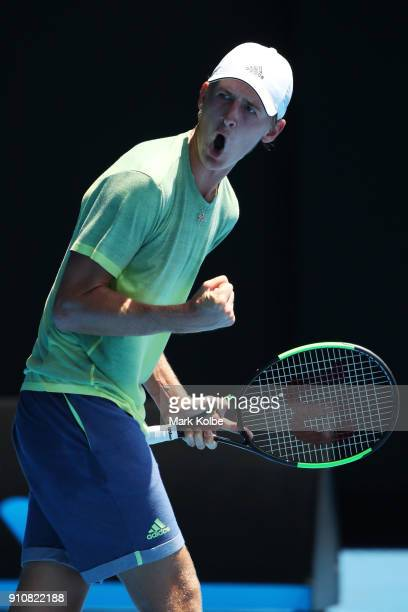 Sebastian Korda of the United States celebrates winning the first set in his Junior Boys' Singles Final against Chun Hsin Tseng of Chinese Taipei...