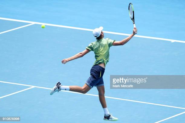 Sebastian Korda of the United States plays a backhand in his Junior Boys' Singles Final against Chun Hsin Tseng of Chinese Taipei during the...