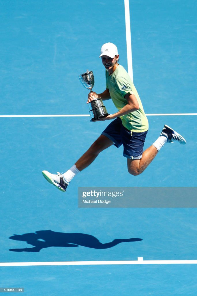 Sebastian Korda of the United States poses with the championship trophy after winning his Junior Boys' Singles Final against Chun Hsin Tseng of Chinese Taipei during the Australian Open 2018 Junior Championships at Melbourne Park on January 27, 2018 in Melbourne, Australia.