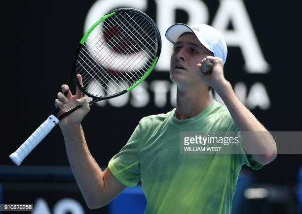 Sebastian Korda of the US celebrates beating Taiwan's Tseng Chun Hsin in their junior boys' singles final match on day 13 of the Australian Open...