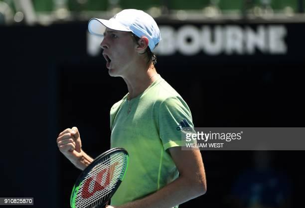 Sebastian Korda of the US reacts against Taiwan's Tseng Chun Hsin during their junior boys' singles final match on day 13 of the Australian Open...