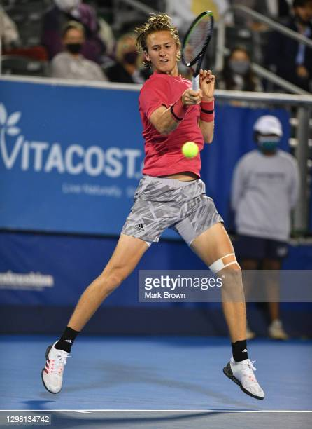 Sebastian Korda returns a shot against Cameron Norrie of Great Britain during the Semifinals of the Delray Beach Open by Vitacost.com at Delray Beach...