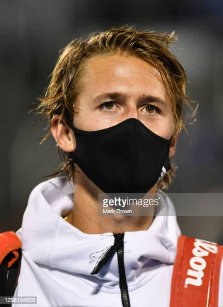 Sebastian Korda wearing a mask while leaving the court after winning against Cameron Norrie of Great Britain during the Semifinals of the Delray...