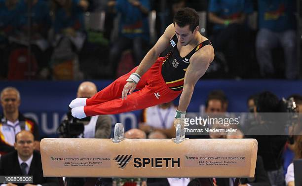 Sebastian Krimmer of Germany performs at the pommel horse during the EnBW Gymnastics Worldcup 2010 at the Porsche Arena on November 13 2010 in...