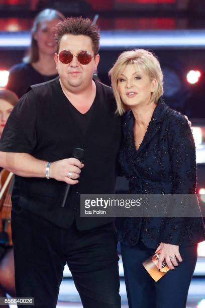 Sebastian Krumbiegel singer of the band 'Die Prinzen' and German presenter Carmen Nebel during the tv show 'Willkommen bei Carmen Nebel' at TUI Arena...