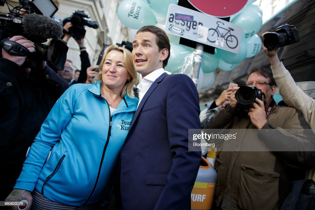 Sebastian Kurz, Austria's foreign minister and leader of the People's Party (OeVP), center, poses for a photograph with a supporter during his final campaign event in Vienna, Austria, on Friday, Oct. 13, 2017. The front-running Peoples Party shifted toward the Freedom Partys hard-line immigration stance, yet on the economy both parties hew to Germanys penchant for tight budgets in the euro area. Photographer: Lisi Niesner/Bloomberg via Getty Images