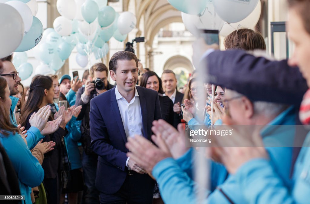 Sebastian Kurz, Austria's foreign minister and leader of the People's Party (OeVP), greets supporters as he arrives during his final campaign event in Vienna, Austria, on Friday, Oct. 13, 2017. The front-running Peoples Party shifted toward the Freedom Partys hard-line immigration stance, yet on the economy both parties hew to Germanys penchant for tight budgets in the euro area. Photographer: Lisi Niesner/Bloomberg via Getty Images